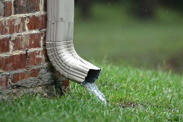 improper positioning of downspouts can cause water infiltration